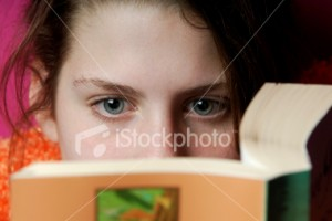 ist2_2688265-teenage-girl-reading-a-book